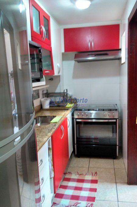 Cozinha com móveis planejados.